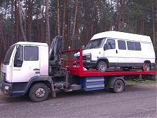 Микроавтобус на платформе эвакуатора МАН